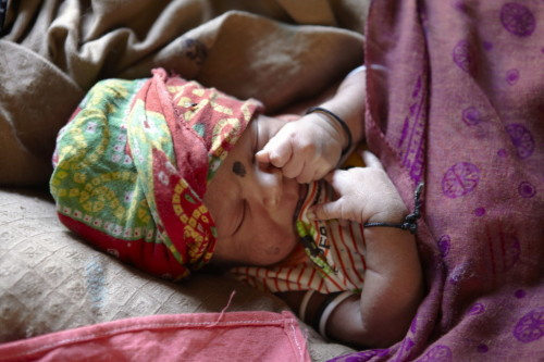 3 day-old baby boy in Dibana village, Maharastra, India.