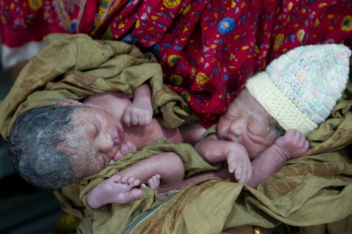 Few hours old twin babies are seen at Pailarkandi union, Baniachang district of Habiganj in Bangladesh.  The twins' mother has had four antenatal visits to the clinic and the babies are full term and a healthy weight.    Every hour, 11 babies die in Bangladesh  their lives cut short before theyre even four weeks old. One in 19 children under five dies needlessly of diseases we know how to treat or prevent. In some regions the figures are even higher: in Baniachong and Ajmiriganj, where Save the Children is working, one baby dies every day, meaning tragically that many women there have lost at least one child. In one village currently without a clinic, locals told us that 9 out of 10 women that live there lose a baby. Most of these children die because they dont have access to even the most basic healthcare.    For every 10 births in Bangladesh, 8 mothers have to give birth in their home on a dirt floor without a skilled health worker present putting the life of their baby at risk.  Only 37% of Bangladeshi children with suspected pneumonia have access to a health worker and only 22% of those receive antibiotics for it. This treatment gap has often tragic consequences.  The lack of good food plays a devastating role, too. Nearly one in four Bangladeshi babies is born underweight, and the damage from malnutrition often lasts a lifetime. Horrifyingly, nearly half of the children in Bangladesh suffer irreparable damage to their bodies and minds  a condition known as stunting  all because they cant get the nutritious food they need to grow and develop. 5% of the worlds children affected by this condition live in Bangladesh.